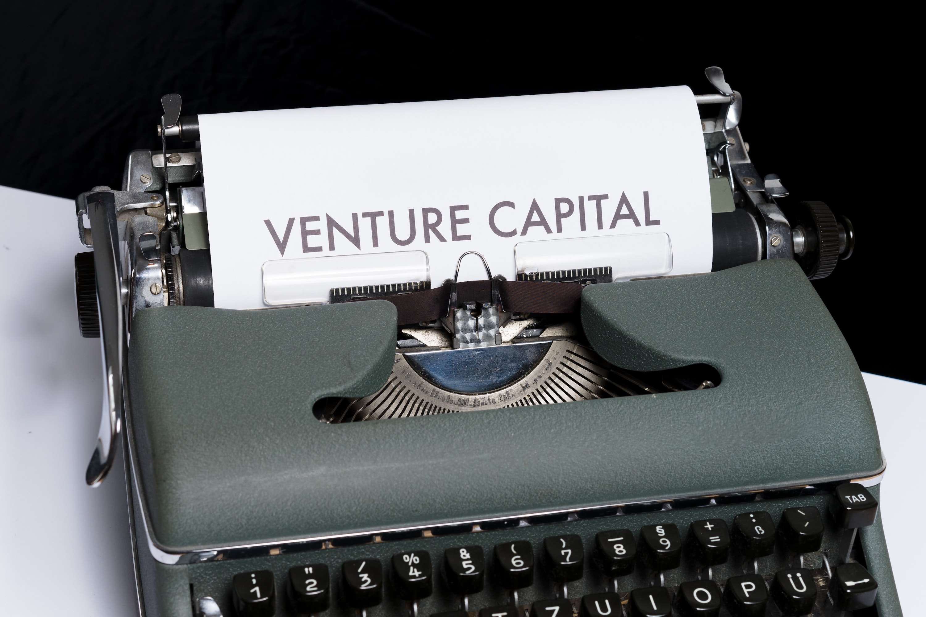 """A typewriter with the words """"Venture Capital"""" typed on the page"""